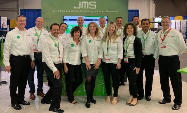 HUB Parking Technology team in front of JMS Janus Management system at IPMI 2019 in Anaheim