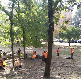 FAAC and HUB volunteers pick up litter from the Reno park in Bologna, Italy